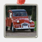 An old red Citroen 2CV car with a smiling woman Metal Ornament