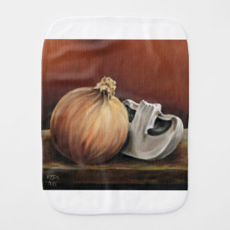 An onion and a mushroom burp cloth