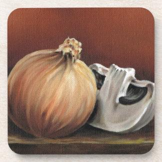 An onion and a mushroom coaster