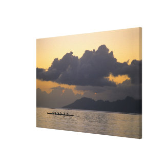 An outrigger canoe team practices off the coast canvas prints
