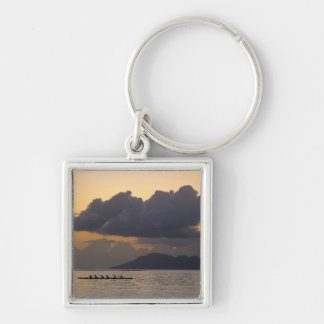 An outrigger canoe team practices off the coast Silver-Colored square key ring
