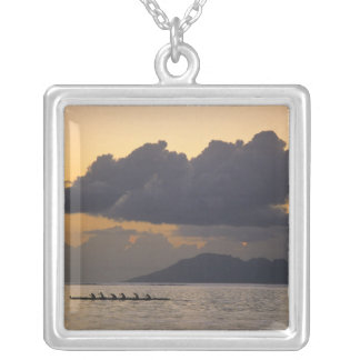An outrigger canoe team practices off the coast square pendant necklace