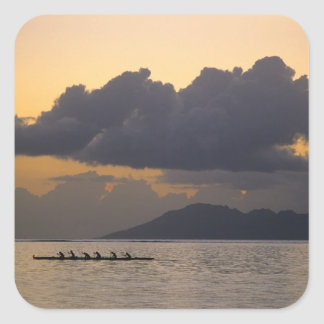 An outrigger canoe team practices off the coast square sticker