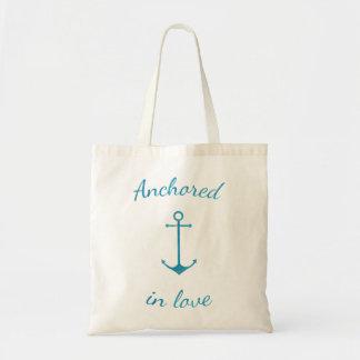 Anchored in love tote bag