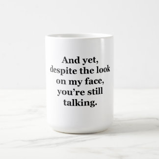 And Yet Despite the Look on my Face Coffee Mug