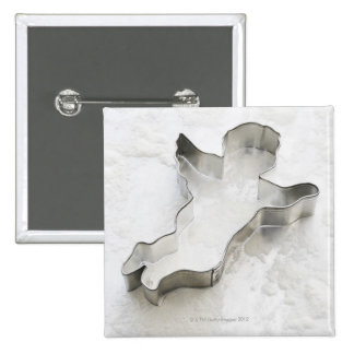 Angel shaped cookie cutter, with flour, close-up 15 cm square badge