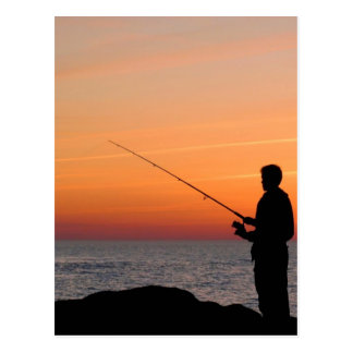 Angler and sunset on shore of the Baltic Sea Postcard