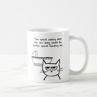 Angry Cat is jealous of the Baby Coffee Mugs