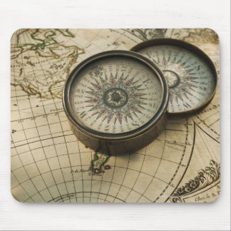 Antique compass on map mouse pad