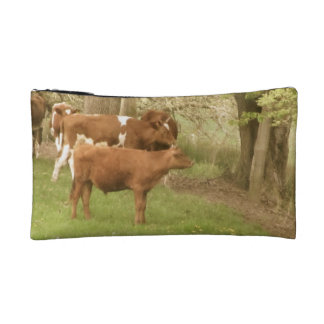 Antique cows in a field cosmetic bags