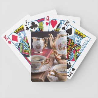 Antique porcelain coffee cups with coffee bicycle playing cards
