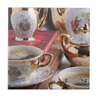 Antique porcelain coffee cups with coffee ceramic tile