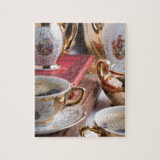 Antique porcelain coffee cups with coffee jigsaw puzzle