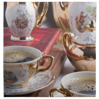 Antique porcelain coffee cups with coffee napkin