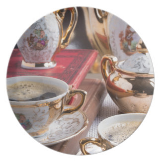 Antique porcelain coffee cups with coffee plate