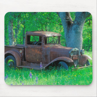 Antique rusted truck in a meadow mouse pad