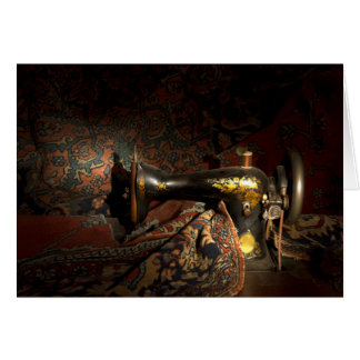 Antique sewing machine with tapestry. card