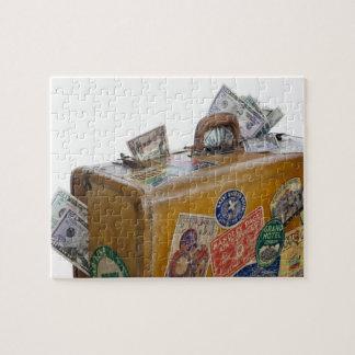 Antique suitcase with protruding money puzzle