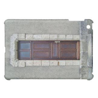 Antique Wooden door in stone wall iPad Mini Cases