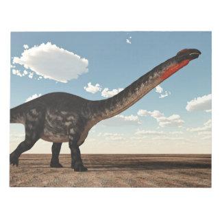 Apatosaurus dinosaur in the desert - 3D render Notepad