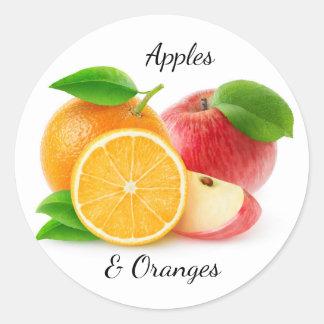Apples and oranges round sticker
