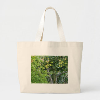 Apples on tree branches and pomegranate tree jumbo tote bag