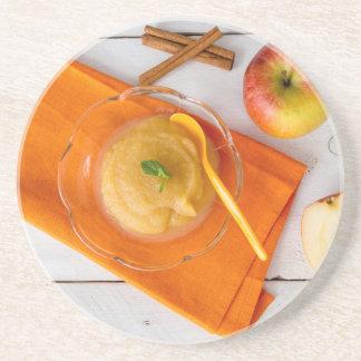 Applesauce with cinnamon and orange spoon beverage coasters