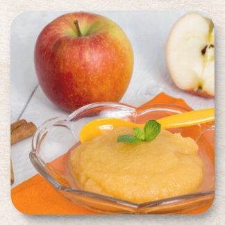 Applesauce with cinnamon and orange spoon beverage coasters