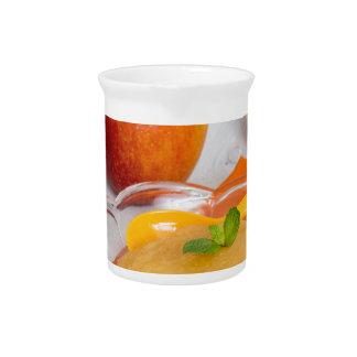 Applesauce with cinnamon and orange spoon beverage pitchers