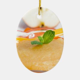 Applesauce with cinnamon and orange spoon ceramic oval decoration