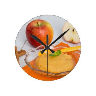 Applesauce with cinnamon and orange spoon clock