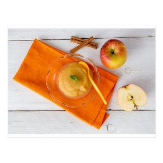 Applesauce with cinnamon and orange spoon postcard