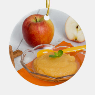 Applesauce with cinnamon and orange spoon round ceramic decoration