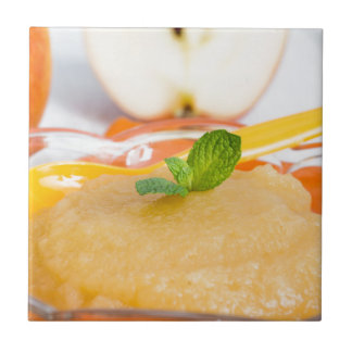 Applesauce with cinnamon and orange spoon small square tile
