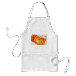 Applesauce with cinnamon and orange spoon standard apron