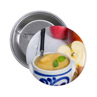 Applesauce with cinnamon in stoneware bowl 6 cm round badge