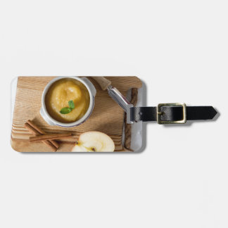 Applesauce with cinnamon in stoneware bowl bag tag