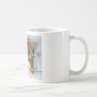 Applesauce with cinnamon in stoneware bowl basic white mug