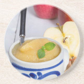 Applesauce with cinnamon in stoneware bowl beverage coasters