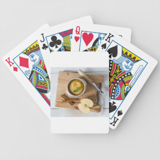 Applesauce with cinnamon in stoneware bowl bicycle poker cards
