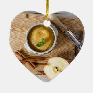 Applesauce with cinnamon in stoneware bowl ceramic heart decoration