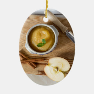 Applesauce with cinnamon in stoneware bowl ceramic oval decoration