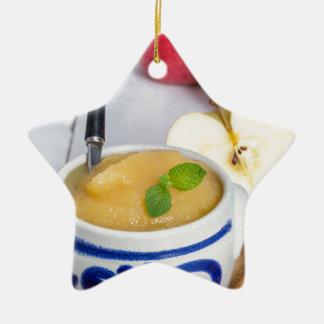 Applesauce with cinnamon in stoneware bowl ceramic star decoration