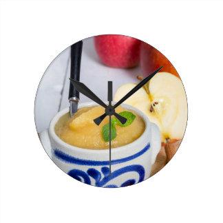 Applesauce with cinnamon in stoneware bowl clock
