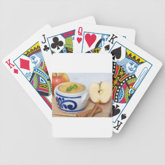 Applesauce with cinnamon in stoneware bowl deck of cards
