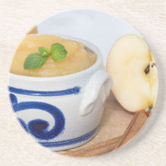 Applesauce with cinnamon in stoneware bowl drink coasters