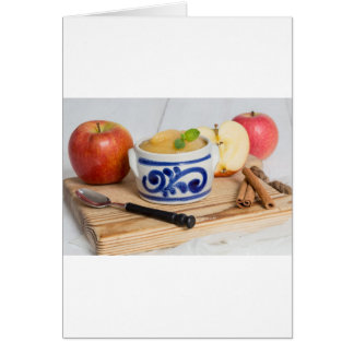 Applesauce with cinnamon in stoneware bowl greeting card