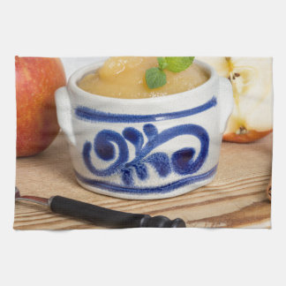 Applesauce with cinnamon in stoneware bowl hand towels