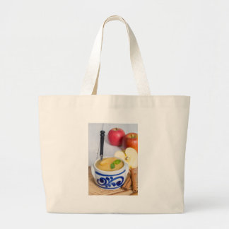 Applesauce with cinnamon in stoneware bowl jumbo tote bag