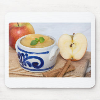 Applesauce with cinnamon in stoneware bowl mouse pad